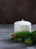 White candle and fir branches Stock Images