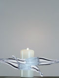White candle with flame being splashed with water Stock Images