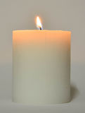 White Candle with flame Royalty Free Stock Images