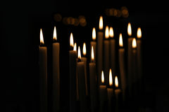 White Candle flames with black background Stock Photo