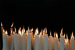 White Candle flames with black background Royalty Free Stock Photography