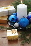 White candle, gift boxes with presents, xmas tree and color balls. Stock Photography