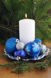 White candle, gift boxes with presents, xmas tree and color balls. Royalty Free Stock Photo