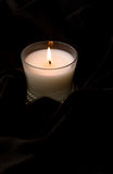 White Candle in Glass. With pearls on black fur Royalty Free Stock Photos