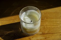 A white candle in a glass jar. royalty free stock images