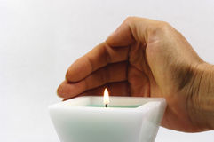 White candle with hand Stock Images
