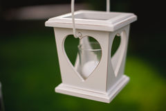 White candle holder with heart shaped hole Royalty Free Stock Photography