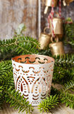 White candle holder with oriental ornaments among fir branches Stock Photography
