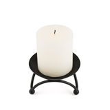 White candle over black metal stand Stock Photos