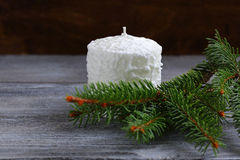 White candle with pine branches Stock Photography