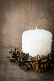 White candle and pine cone Royalty Free Stock Photos