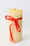 White Candle with red ribbon holidays.  Stock Photography