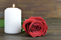 White candle and red rose Royalty Free Stock Images