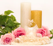 White candle and roses Stock Photos
