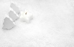 White candle in the snow Royalty Free Stock Photos