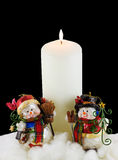 White Candle and Snowmen Stock Photos