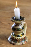 White candle on vintage candle holder Royalty Free Stock Image