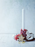 White candle and vintage Christmas decorations Royalty Free Stock Images