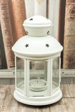 White candleholder with stars and candle. White candleholder with stars in crystals, stars at the top pierced in the metal and central candle holders stock photos
