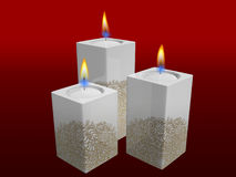 White candles. With golden floral pattern of christmas on red background Stock Photos