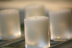 White Candles. Romantic light with white candles Royalty Free Stock Images