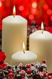 White candles in autumn winter decoration Stock Photos