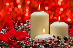 White candles in autumn winter decoration Royalty Free Stock Photography