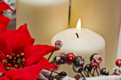 White candles in autumn winter decoration Royalty Free Stock Images