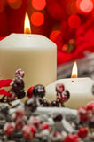 White candles in autumn winter decoration Stock Photo