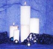 White candles with blue decorations Royalty Free Stock Photos