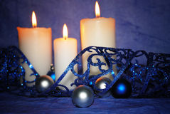 White candles with blue decorations Stock Photo