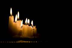 White candles burning in the dark Royalty Free Stock Photography