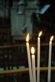 White candles in catholic church Stock Photos