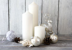 White candles with and Christmas balls, decor deer Stock Photo