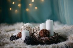 white candles and decor items on white carpet royalty free stock images