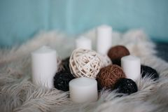 white candles and decor items on white carpet royalty free stock photo