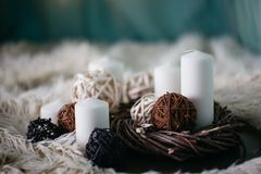 White candles and decor items on white carpet. White candles and decor items on a carpet royalty free stock photo