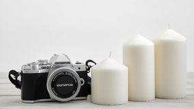 White candles with digital cameras stock photo