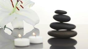 White candles near black stones stock video