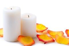 White candles and petals of tea-rose close up Stock Photos