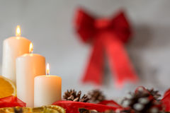White candles and red ribbon Royalty Free Stock Image