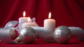 White candles and silver balls Stock Photography