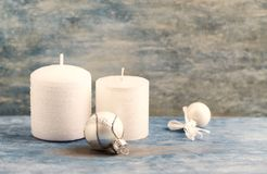 White candles and small Christmas baubles. Christmas decoration. Christmas time. royalty free stock photos