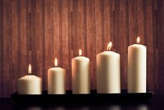 White candles on warm atmosphere Royalty Free Stock Image