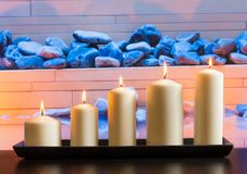 White candles on wood table Royalty Free Stock Images