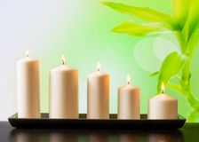 White candles on wood table Royalty Free Stock Photo