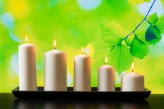 White candles on wood table Stock Photography