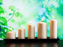 White candles on wood table Royalty Free Stock Image
