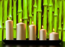 White candles on wood table Royalty Free Stock Photos