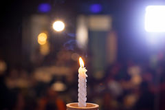 White candlesticks with blur bokeh background. image for background. Wallpaper and copy space. rest in peace concept. romantic dinner for aniversary concept Stock Images